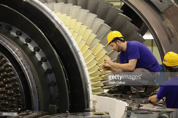 Workers assemble a gas turbine at the Siemens gas turbine factory on January 8 2010 in Berlin Germany Recent economic data including...