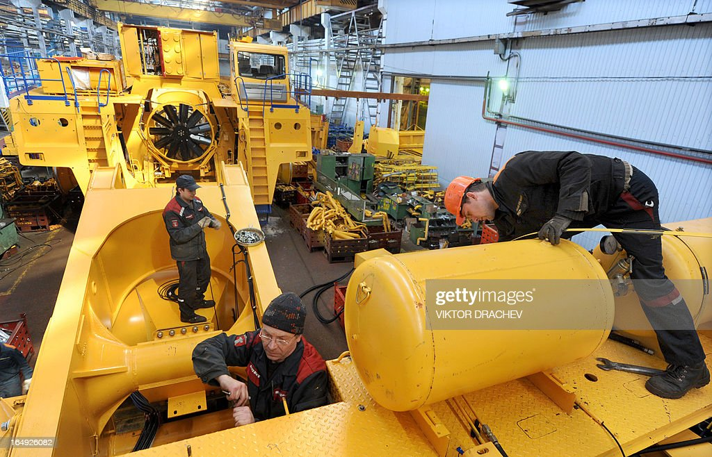 Workers assemble a heavy duty BelAZ dump-truck at the assembly department of the BelAZ automobile plant in the Belarus town of Zhodino, some 50km north of the capital Minsk, on March 29, 2013.