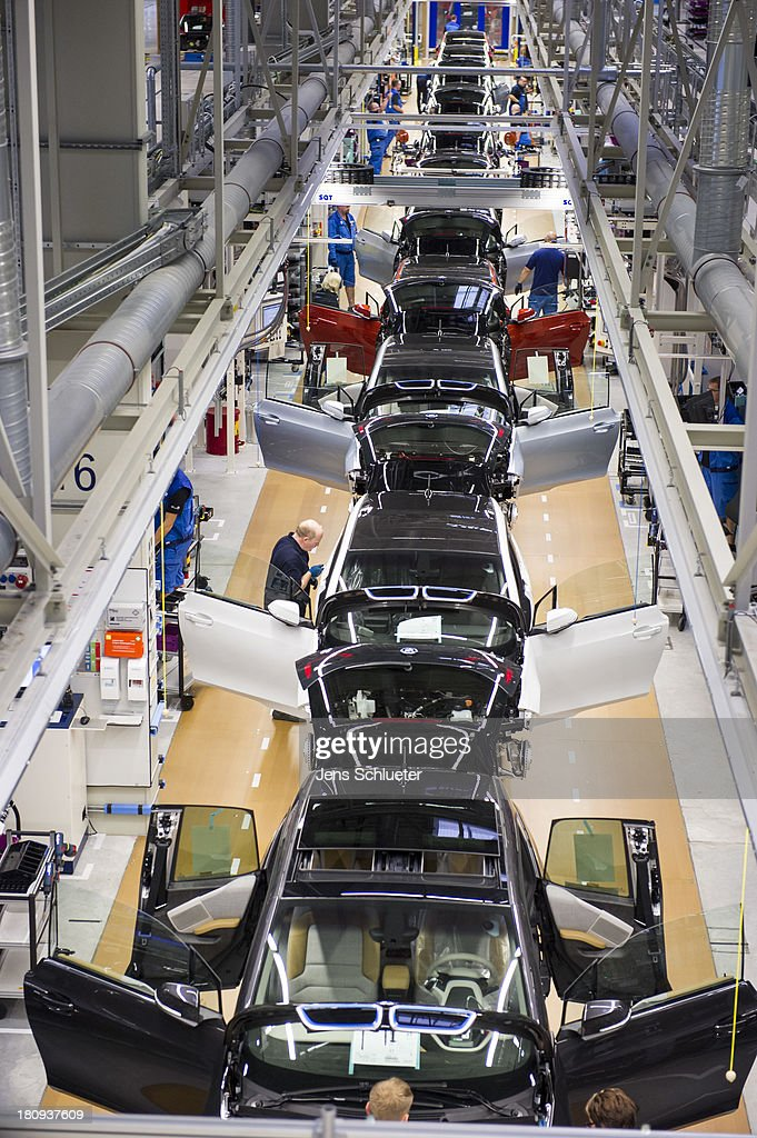 Workers assemble a new BMW i3 electric car on the assembly line at the BMW factory on September 18, 2013 in Leipzig, Germany. The i3 is BMW's first mass market electric car and the company has invested EUR 400 million into its production at the Leipzig factory.
