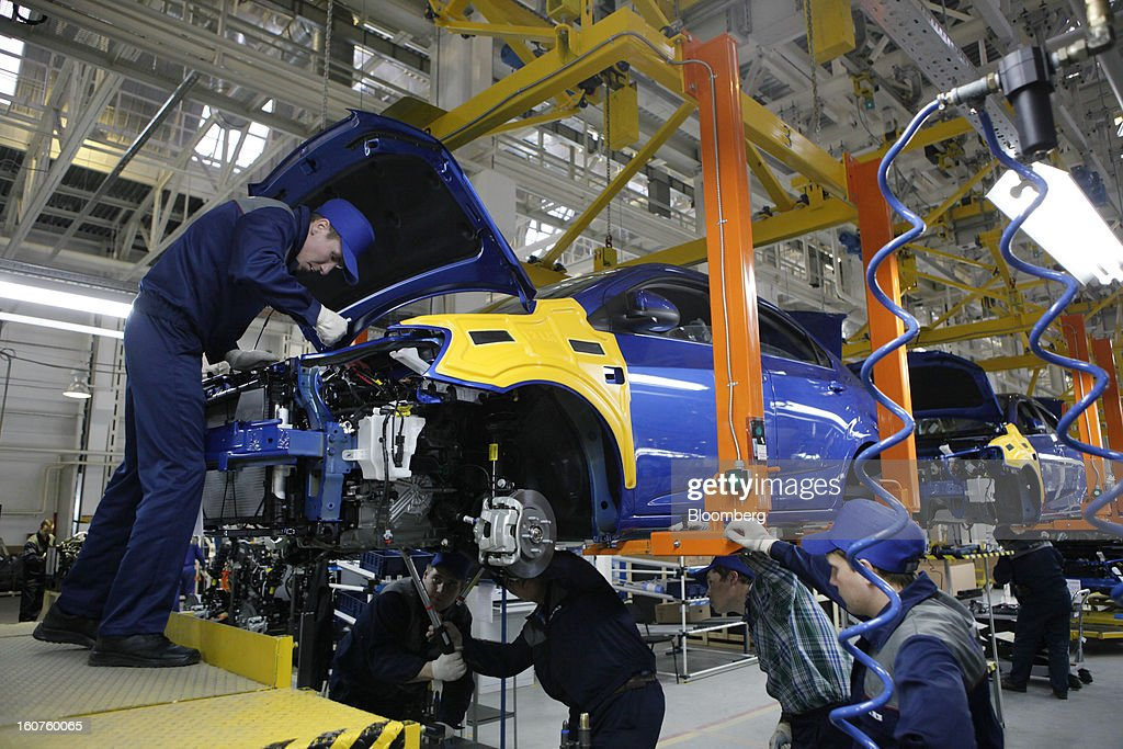 Workers assemble a new Chevrolet Aveo automobile, a division of General Motors Co. (GM), on the production line at the GAZ Group plant in Niznhy Novgorod, Russia, on Tuesday, Feb. 5, 2013. GAZ, which is controlled by Russian billionaire Oleg Deripaska, plans to make 30,000 Aveo sedans and hatchbacks a year at its plant in Nizhny Novgorod starting in mid-2012. Photographer: Alexander Zemlianichenko Jr./Bloomberg via Getty Images