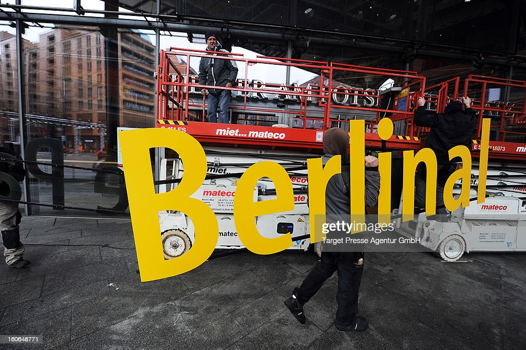 Workers assemble a signboard at the Berlinale Palast for the 63rd Berlinale International Film Festival on February 4, 2013 in Berlin, Germany. The 2013 Berlinale will run from February 7-17, 2013