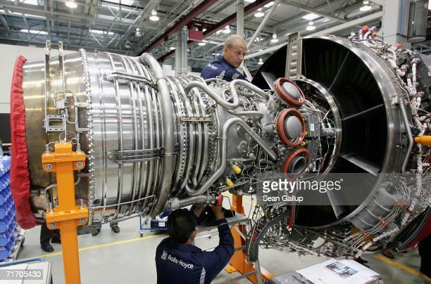 Workers assemble an aircraft jet engine August 23 2006 at the RollsRoyce aircraft engine factory in Berlin Germany The factory a greenfield project...