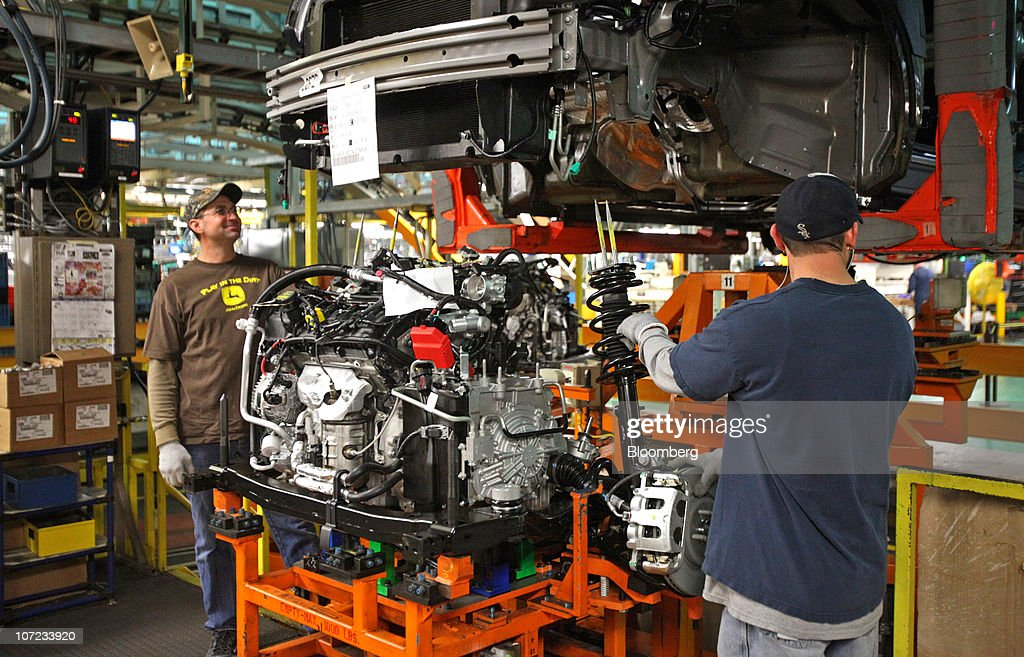 Workers Assemble An Engine For The 2011 Ford Motor Co