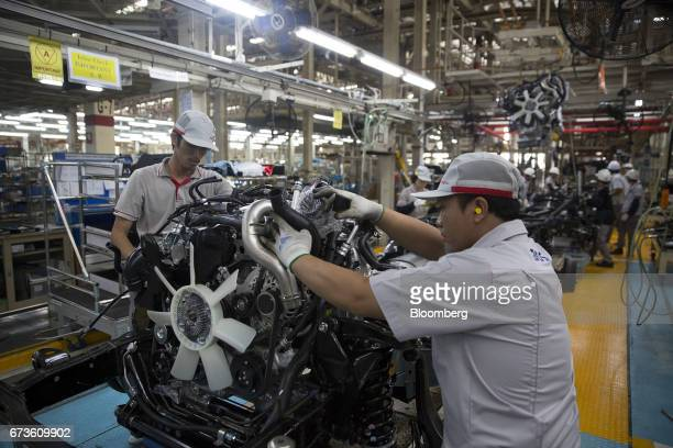 Workers assemble an engine of a Nissan Motor Co Navara pickup truck at the company's plant in Samut Prakan Thailand on Tuesday April 25 2017 Nissan...