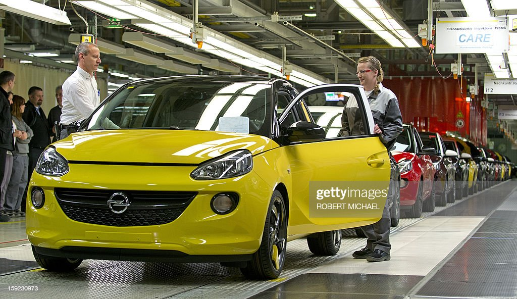 Workers assemble an Opel Adam car during the opening ceremony at the Opel plant in Eisenach, eastern Germany on January 10, 2013. The new Opel model will be produced as of January 10, 2013 at the Eisenach Opel plant and is intended to attract young automobile drivers in cities. Opel has already received 16 000 orders for the Adam.