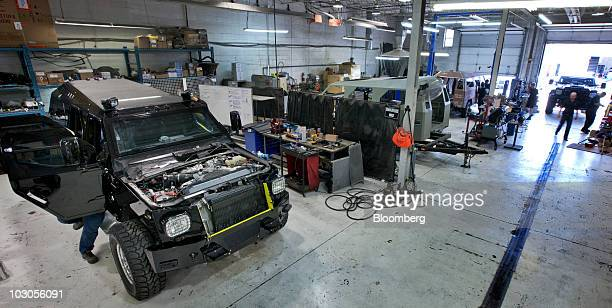 Workers assemble Conquest Knight XV armored sport utility vehicles at the company's assembly facility in Markham Ontario Canada on Tuesday July 20...