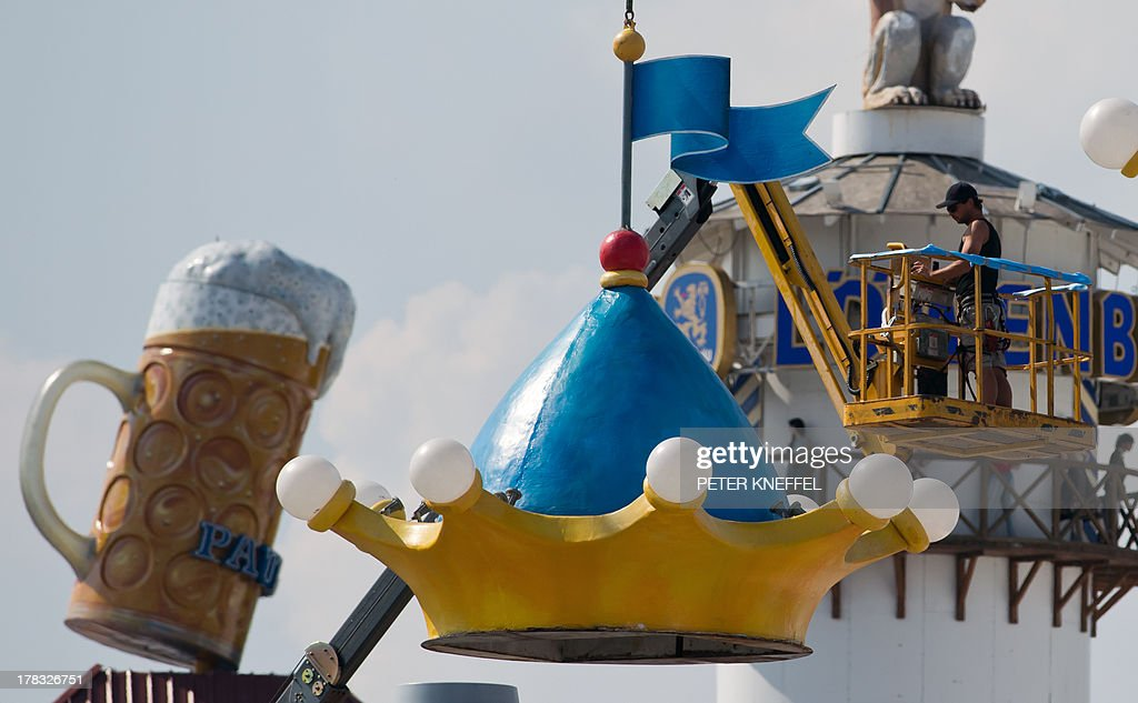 Workers assemble decorations as preparations are under way for the Oktoberfest beer festival on August 29, 2013 in Munich, southern Germany. The world famous Oktoberfest will take place from September 21 to October 6, 2013.