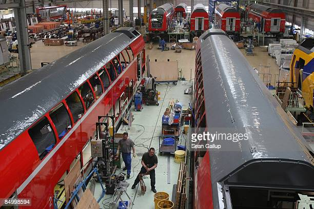 Workers assemble double decker passenger cars for German state railways Deutsche Bahn at the train factory of Canadian company Bombardier on February...