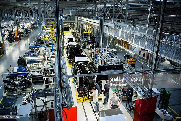 Workers assemble MercedesBenz AG GClass automobiles on the production line at the Magna International Inc plant in Graz Austria on Thursday Dec 3...