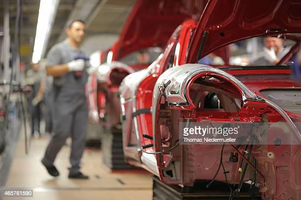 Workers assemble Porsche 911 cars at the Zuffenhausen Porsche production plant on March 10 2015 in Stuttgart Germany Porsche will announce the...