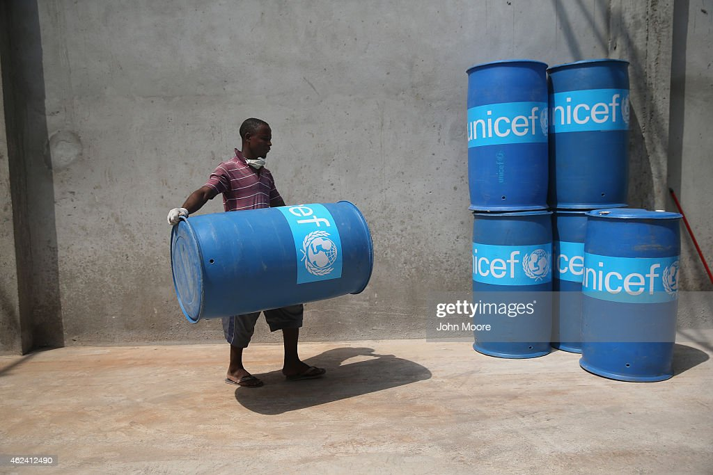 UNICEF workers assemble 'school infection prevention kits' to stop the spread of Ebola in schools scheduled to open next week on January 28 2015 in...