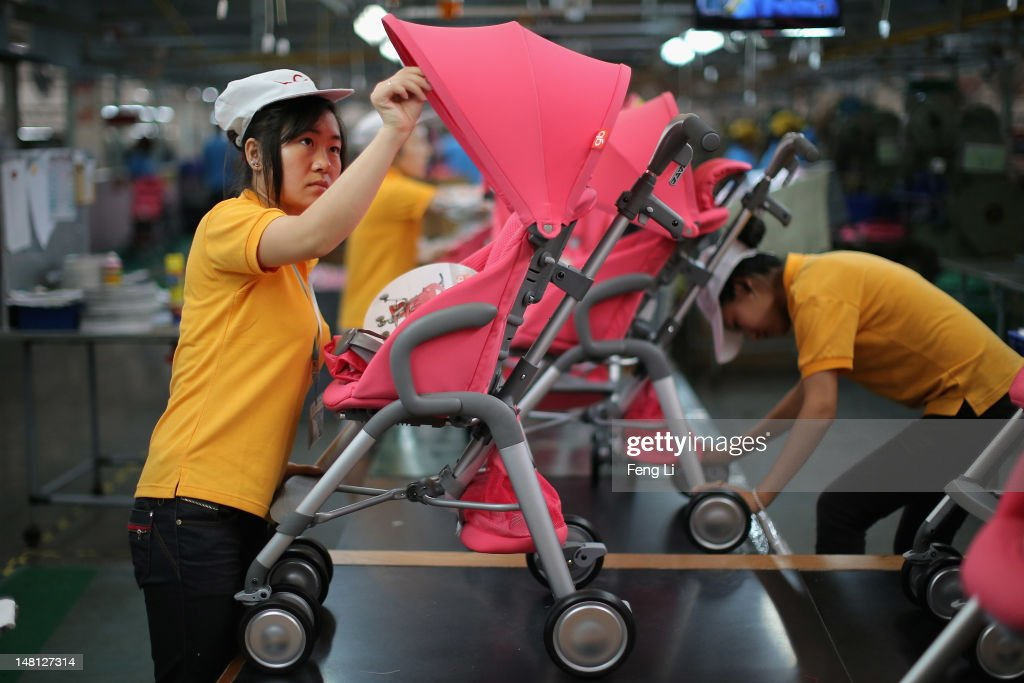 Workers assemble strollers at the production line of Goodbaby Group Co., Ltd. on July 6, 2012 in Kunshan of Jiangsu Province, China. Chinese Premier Wen Jiabao said Tuesday that stabilizing economic growth is the most pressing matter currently facing China. China's central bank's sudden cut in the benchmark interest rates for the second time in a month confirmed the pessimistic view of the current economic situation.