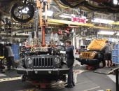 Workers assemble the 2014 Jeep Wrangler at the Chrysler Toledo North Assembly Plant Jeep May 7 2014 in Toledo Ohio Fiat Chrysler Automobiles...