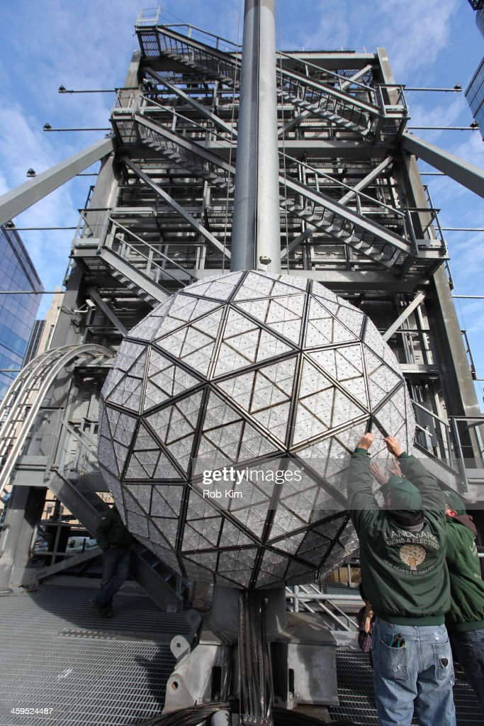 Workers assemble the 2014 New Year's Eve Waterford Crystal ball during its installation at One Times Square on December 27, 2013 in New York City.