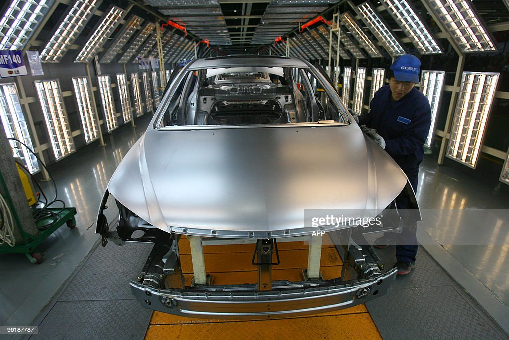 Workers assemble the cars at a Gelly Autommobile factory that may produce Volvo cars in the future in Ningbo east China's Zhejiang province on...