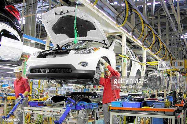 Workers assemble the Fuga on the production line at the Nissan Motor Co's Kaminokawa Factory on November 1 2009 in Kaminokawa Tochigi Japan