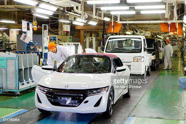 Workers assemble the Honda Motor's S660 in the production line at Yachiyo Industry Yokkaichi Factory on May 26 2015 in Yokkaichi Mie Japan Honda...