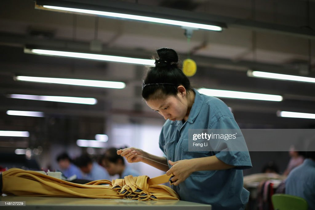 Workers assemble tie at the production line of Babei Group Co., Ltd on July 3, 2012 in Shengzhou of Zhejiang Province, China. Chinese Premier Wen Jiabao said Tuesday that stabilizing economic growth is the most pressing matter currently facing China. China's central bank's sudden cut in the benchmark interest rates for the second time in a month confirmed the pessimistic view of the current economic situation.