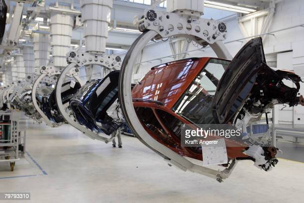 Workers assemble Touran cars at the production line at the Volkswagen factory February 15 2008 in Wolfsburg Germany The Tiguan and the Touran are...