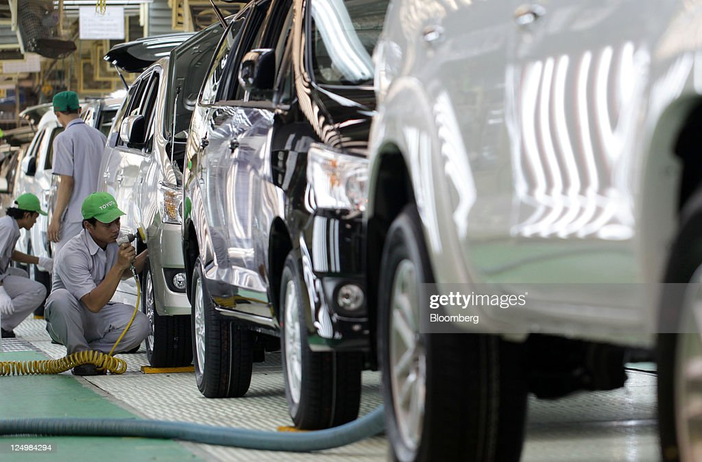Workers assemble Toyota Motor Corp. vehicles on the production line of PT. Toyota Motor Manufacturing Indonesia's (TMMIN) Karawang plant in Karawang, West Java, Indonesia, on Wednesday, Sept. 14, 2011. Toyota Motor Corp., the biggest carmaker in Asia, plans to build a second factory in Indonesia at a cost of 26.3 billion yen ($341 million) to help boost sales in emerging markets. Photographer: Dimas Ardian/Bloomberg via Getty Images