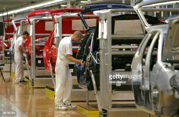 Workers assemble Volkswagen Polo compact cars October 29 2003 at the Volkswagen factory just outside Bratislava Slovakia The factory produces the VW...