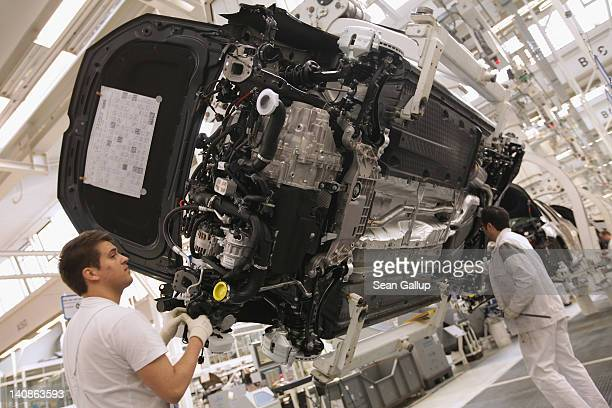 Workers assemble Volkswagen Touran and Tiguan cars at the Volkswagen factory on March 7 2012 in Wolfsburg Germany In 2011 Volkswagen achieved record...