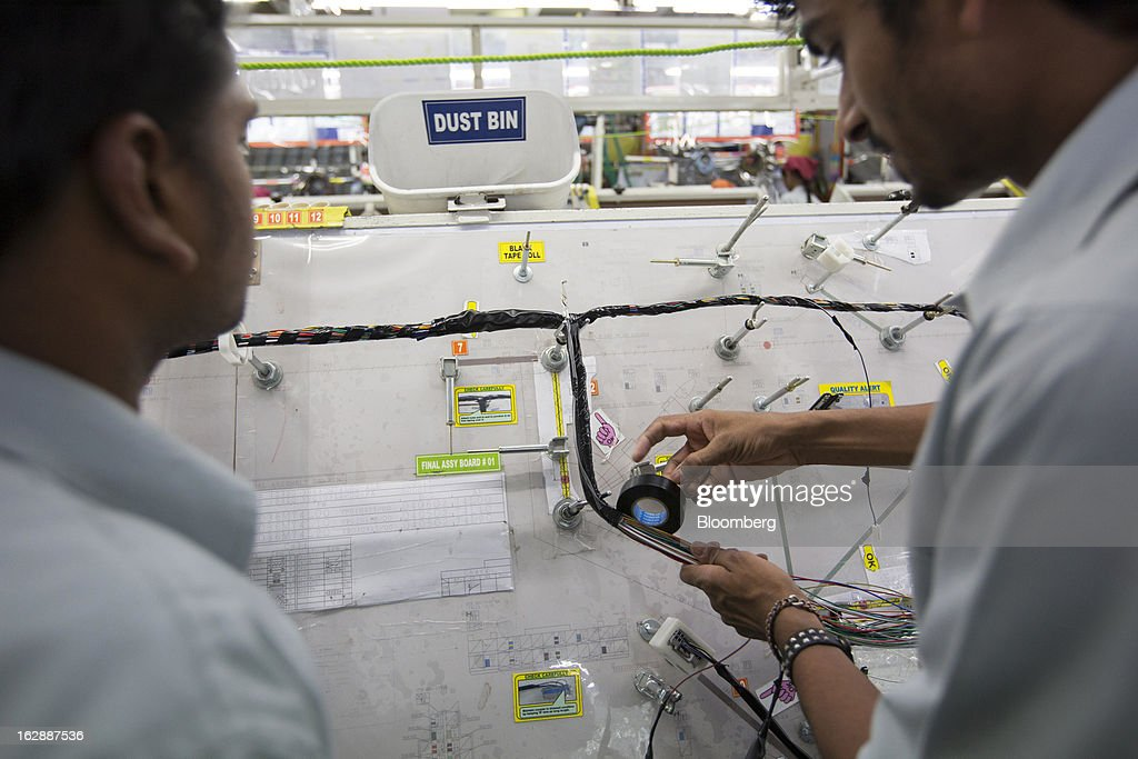 workers assemble wire harnesses at the motherson sumi systems ltd picture id162887536 electric wire motherson sumi electric wire jk sumi wire harness sdn bhd at virtualis.co