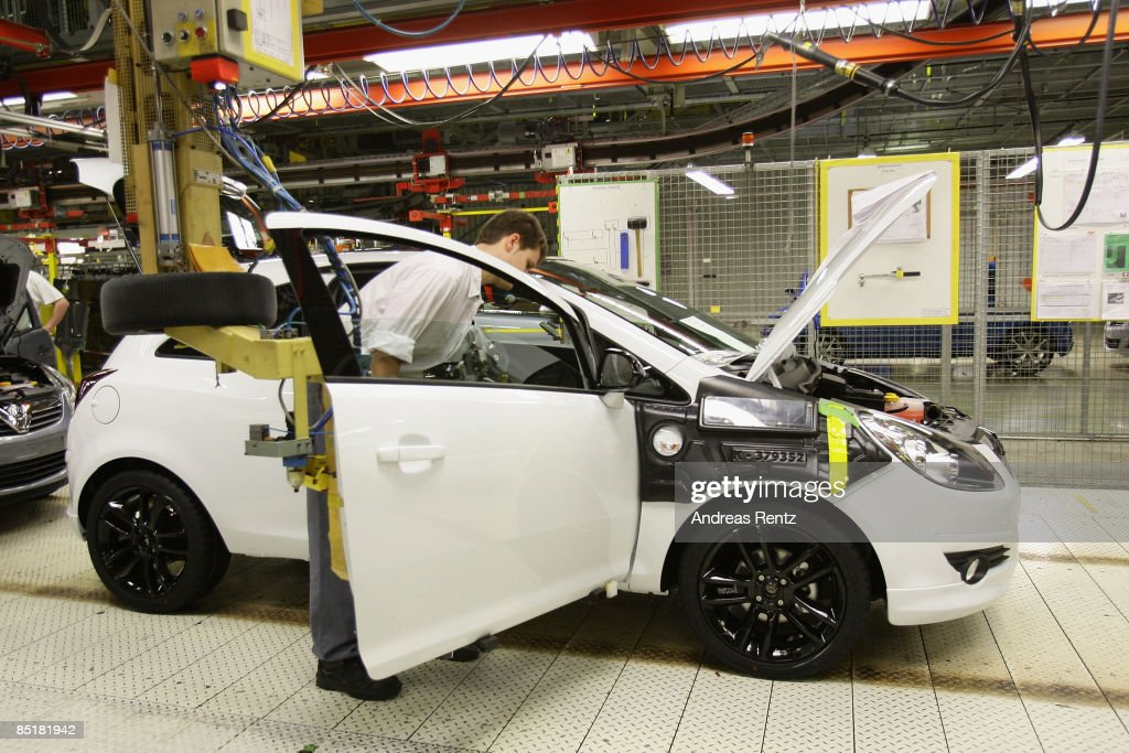Workers assembling an Opel Corsa car at the plant of car maker Opel on March 2, 2009 in Eisenach, Germany. Opel announces a business plan directed to the German government to substantiate the demand for subsidy. Opel needs a rescue package of 3.3 billion euros to stay solvent due to serious difficulties of GM.