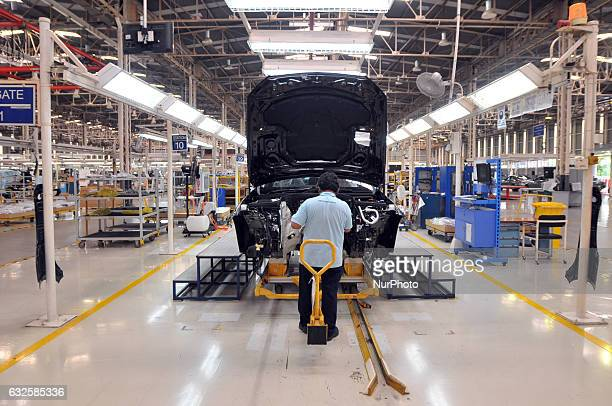 Workers assembling car type sedan EClass at MercedesBenz plant in Wanaherang district Bogor West Java on January 24 2017 MercedesBenz Indonesia...