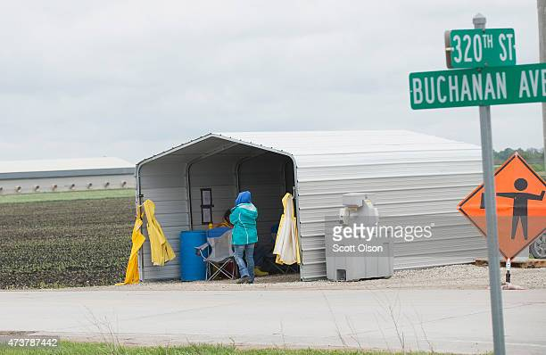 Workers at a checkpoint prevent people from driving down Buchanan Avenue near a farm operated by Daybreak Foods which has been designated 'bio...