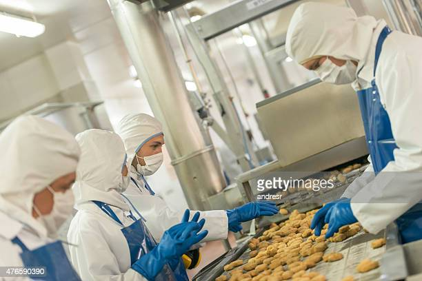 Workers at a food factory working at the production line