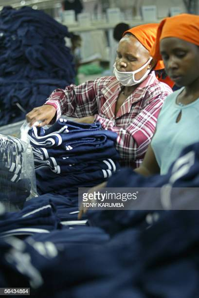 Workers at a textile processing and export factory in Kenya package finished garments 15 December 2005 African producers whose sales are hurt by...
