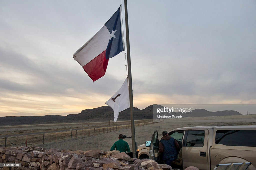 Workers at Cibolo Creek Ranch lower the Texas flag to half mast on Sunday, the day after the death of Supreme Court Justice Antonin Scalia, February 14, 2016 in Shafter, Texas. Supreme Court Justice Antonin Scalia was at a Texas Ranch Saturday morning when he died at the age of 79.