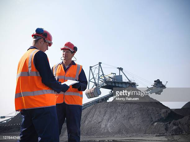 Workers at coal storage facility