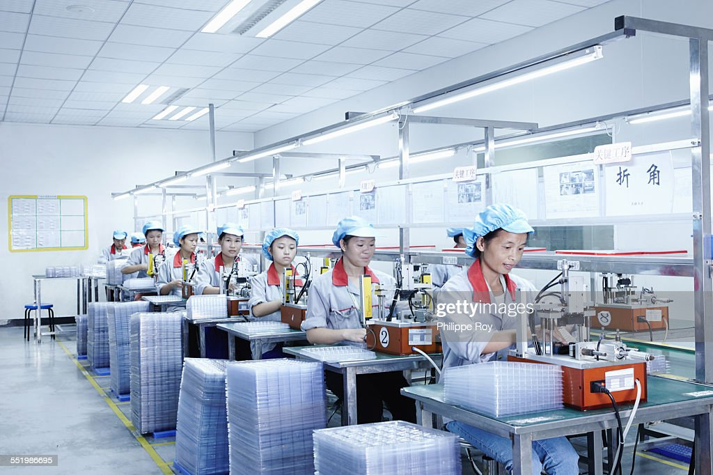 Workers at e-cigarettes battery factory, Guangdong, China