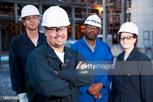 Workers at manufacturing plant