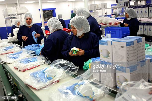 Workers at Medline Industries assemble Personal Protection Equipment kits to be shipped out to various health facilities at their warehouse in...