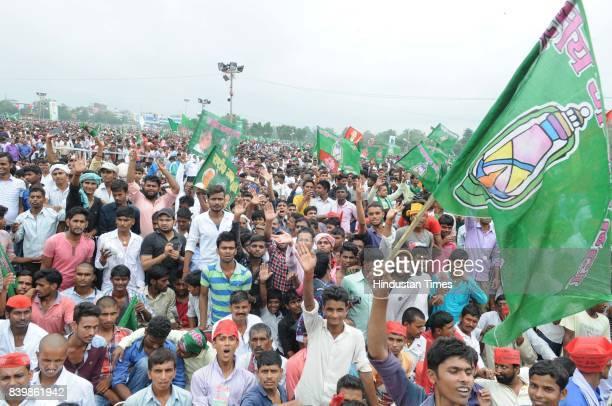RJD workers at mega rally 'BJP Bhagao Desh Bachao' organised by Rashtriya Janata Dal at Gandhi Maidan on August 27 2017 in Patna India RJD Chief Lalu...