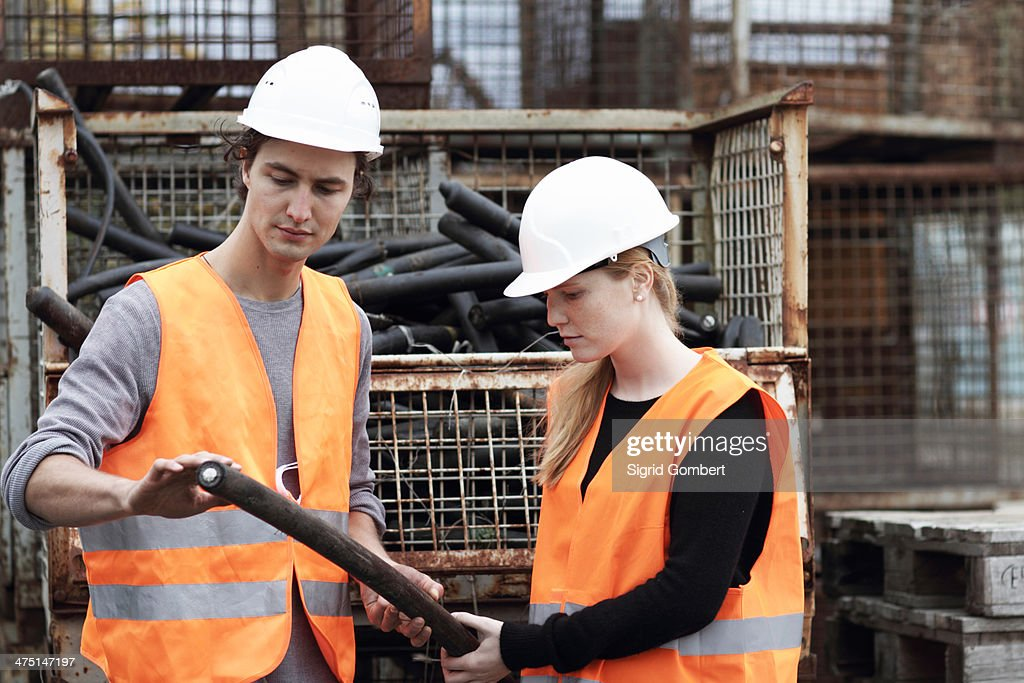 Workers at metal recycling plant : Stock Photo