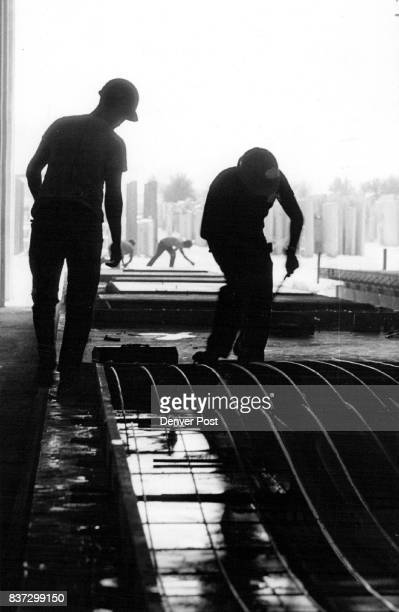 Workers at Prestressed Concrete of Colorado prepare forms for precast walls All work in the factory is done by 30 minority workers living in...
