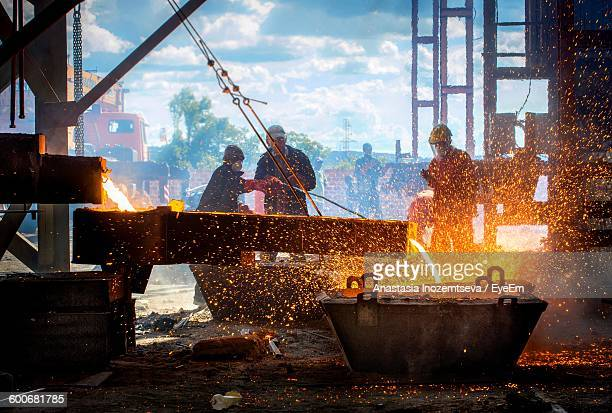 Workers At Steel Mill