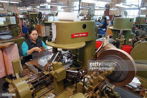 Workers at the at JC Newman cigar factory using vintage machines some 90 years old make cigars on April 21 in Tampa Bay Florida Company President...