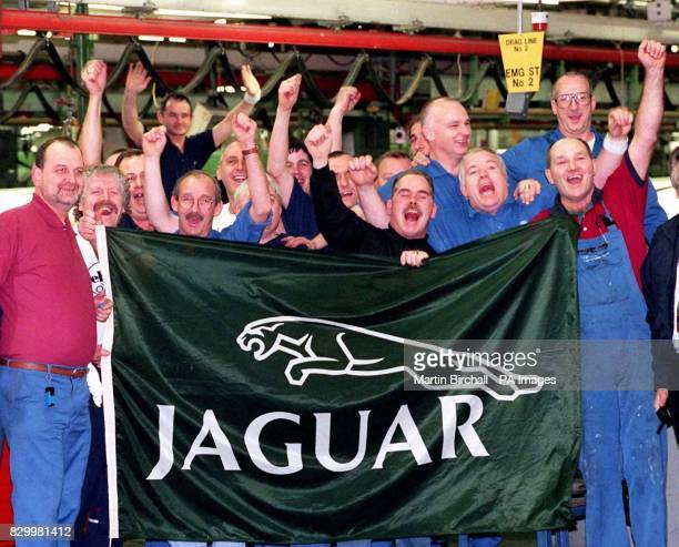 Workers at the Ford Halewood celebrate the announcement by the luxury car company Jaguar today that their latest small sports saloon will be built at...