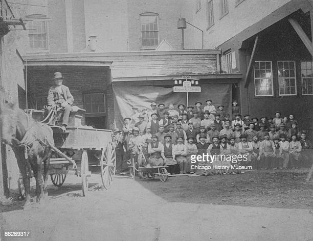 Workers at the Horn Brothers Furniture Company assembled the day before a national strike in support of the eight hour day Chicago April 1886 Tens of...