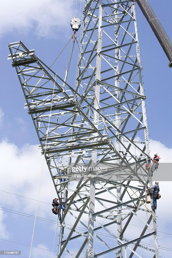 Workers at the installation of an electricity pylon for a 380 kV high-voltage power line on July 10, 2013 near Meckenheim Germany.