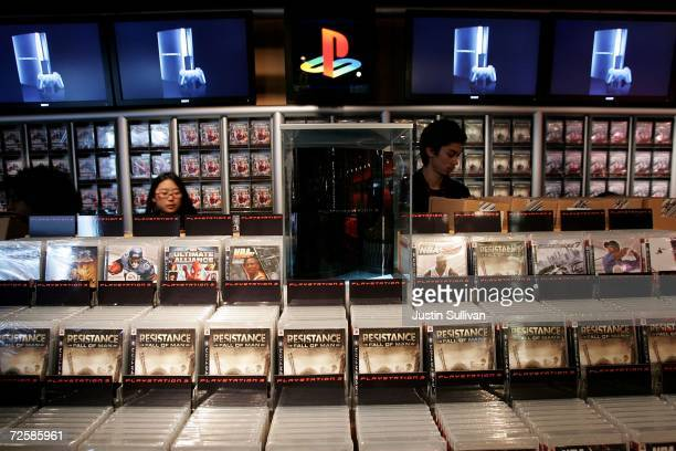 Workers at the Sony Playstation store set up displays of video games designed for the new Playstation 3 November 16 2006 in San Francisco California...