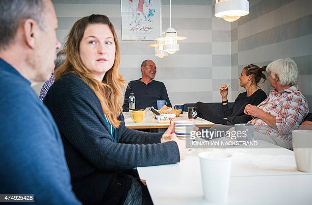 Workers at the Swedish Handball Federation meet for a traditional 'Fika' Swedish type of coffee break on May 27 2015 in Stockholm Sweden AFP...