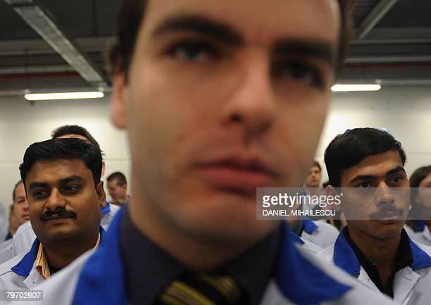 Workers attend the inauguration of the Finnish cellphone maker Nokia first assembly line of a total investment of 60 million euros at the Nokia plant...