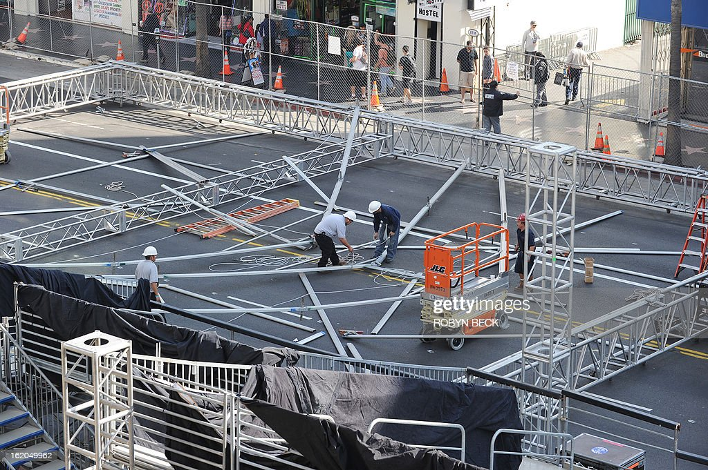 Workers begin building scaffolding in the center of Hollywood Boulevard for the 85th Academy Awards ceremony, February 18, 2013 in Hollywood, California. A section of Hollywood Boulevard in front of the Dolby Theatre will be closed for the entire week as crews build press risers and fan bleachers and roll out the red carpet for the Academy Awards ceremony, which will take place on February 24 in the Dolby Theatre. AFP PHOTO Robyn BECK