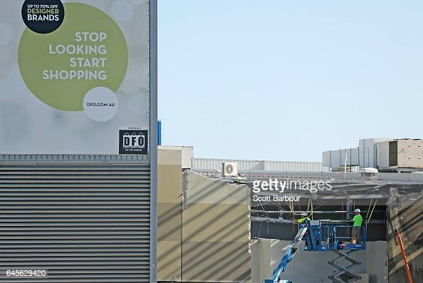 Workers begin to repair the scene of the crash at the DFO Essendon Homemaker Centre as the centre reopened on Monday excluding 12 homemaker stores...